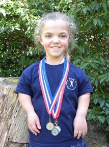 Millie Gains Three Golds at National Sports Event