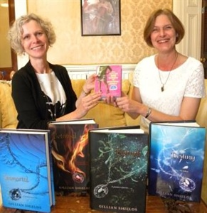 Author Presents Signed Copies of Books to School Library
