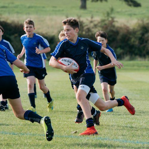 school boys playing rugby