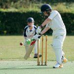 school boys playing cricket